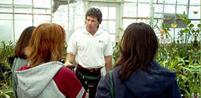 Photo: Horticultural Therapy Studies. Professor Joel Flagler lectures in the Rutgers Floriculture Greenhouse.